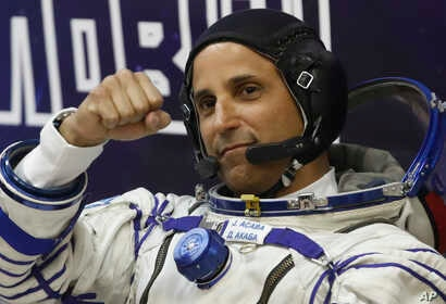 U.S. astronaut Joseph Acaba, crew member of the mission to the International Space Station, gestures prior the launch of Soyuz-FG rocket, Sept. 12, 2017.