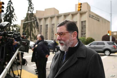 In this Oct. 28, 2018 photo, Pittsburgh Mayor Bill Peduto walks in view of the Tree of Life Synagogue in Pittsburgh.