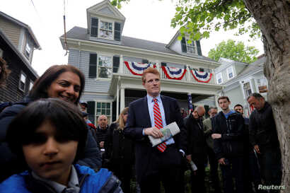 FILE - U.S. Congressman Joe Kennedy III waits to speak at ceremonies on the 100th anniversary of the birth of Congressman Kennedy's great-uncle, U.S. President John F. Kennedy, outside the home where President Kennedy was born, in Brookline, Massachu...