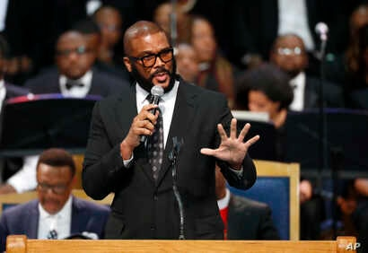 Tyler Perry speaks during the funeral service for Aretha Franklin at Greater Grace Temple, Aug. 31, 2018, in Detroit.