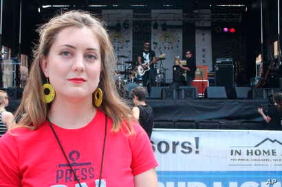 Winters Geimer, the daughter of slain journalist Wendi Winters, stands in front of a stage during a benefit concert on Saturday, July 28, 2018 in Annapolis, Md.