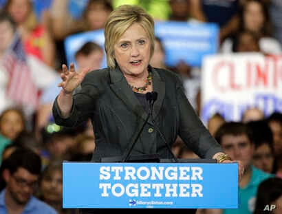 Democratic presidential candidate Hillary Clinton gestures as she speaks during a rally in Raleigh, N.C., June 22, 2016.