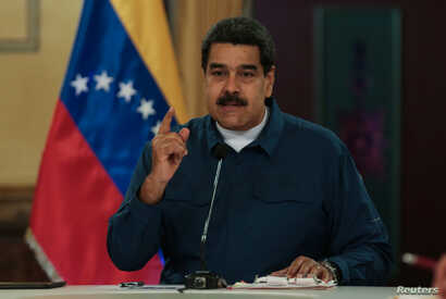 Venezuela's President Nicolas Maduro speaks during a meeting with ministers at the Miraflores Palace in Caracas, Venezuela, Aug. 13, 2018.