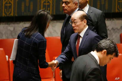 U.S. Ambassador to the United Nations Nikki Haley speaks to China's U.N. Ambassador Liu Jieyi after a vote to adopt a new sanctions resolution against North Korea during a meeting of the U.N. Security Council, Sept. 11, 2017.