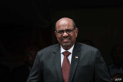 Sudan's President Omar al-Bashir prepares make a speech  opening the Djibouti International Free Trade Zone in Djibouti on July 5, 2018.  Al-Bashir is expected to continue working on the finer points of the South Sudan peace agreement.