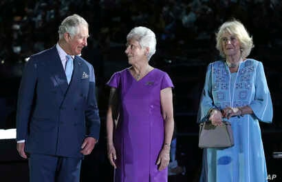 Prince Charles and Camilla, Duchess of Cornwall, right, are greeted by Louise Martin, president of the Commonwealth Games Federation, as they arrive during the opening ceremony for the 2018 Commonwealth Games at Carrara Stadium on the Gold Coast, Aus...