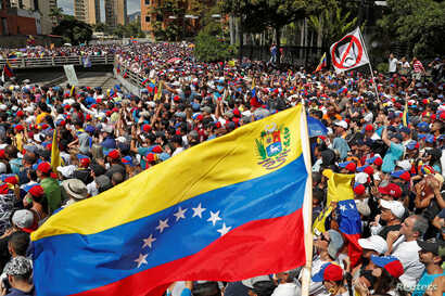 Opposition supporters take part in a rally against Venezuelan President Nicolas Maduro's government  in Caracas, Venezuela Jan. 23, 2019.