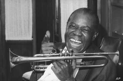 Jazz trumpeter Louis Armstrong shown in the upstairs den of his Corona, New York home, June 23, 1971.