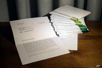 In this photo of a letter released by Vatican Media, retired Pope Benedict XVI praises a volume of books about the theological training of Pope Francis.