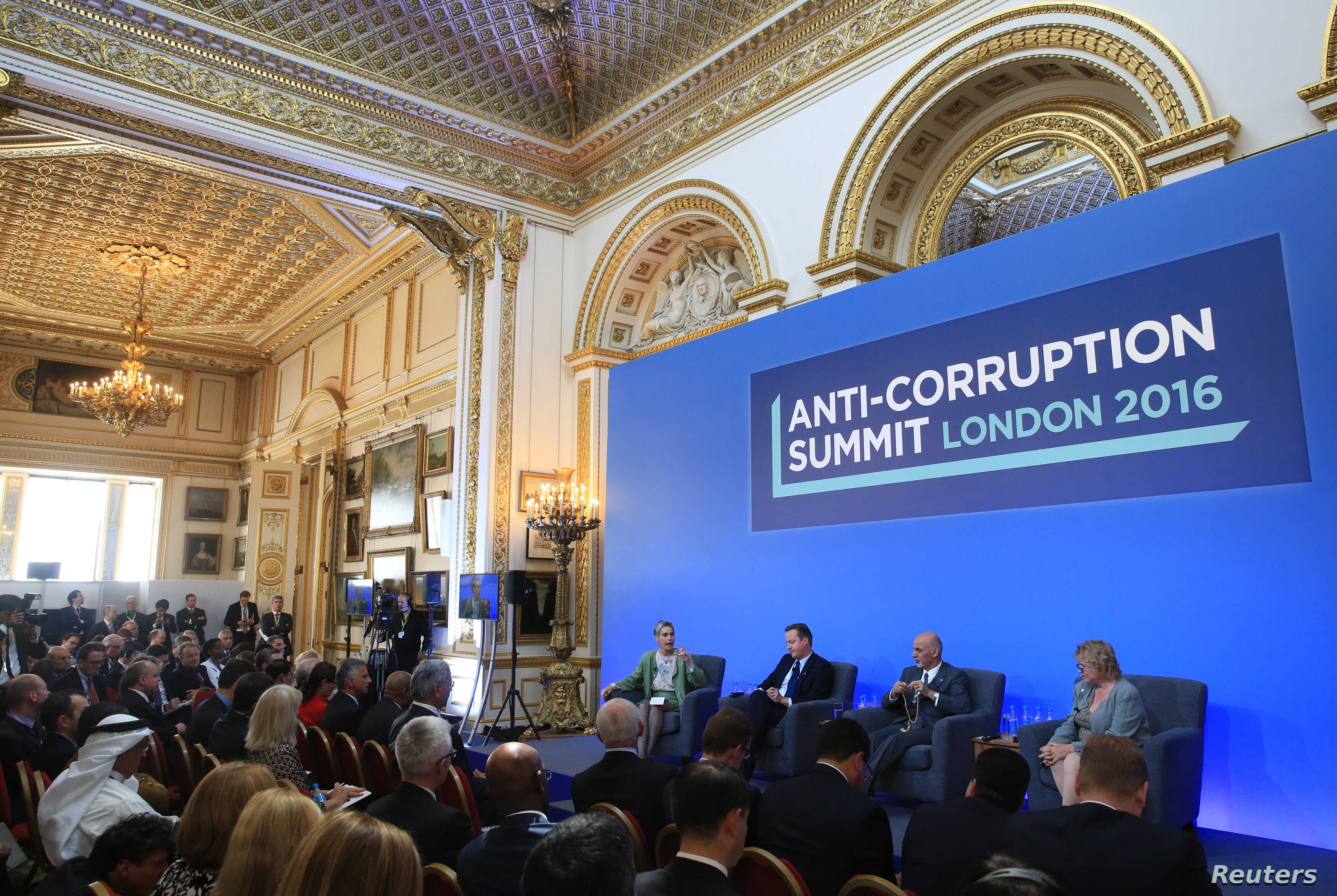 (L-R) Sarah Chayes from the Carnegie Endownment for International Peace,British Prime Minister Cameron, Afghan President Ghani and French magistrate Eva Jolly share a platform at the international anti-corruption summit, London, Britain, May 12, 2016...