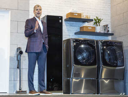 Dave VanderWaal of LG Electronics USA shows off ProActive Customer Care, an AI-powered customer service tool for home appliances during 2019 International CES in Las Vegas, Jan. 7, 2019.