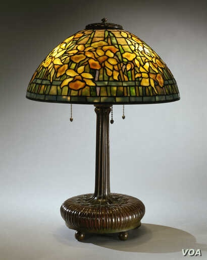 "The ""Daffodil"" lampshade the Neustadts purchased from a second-hand shop in Greenwich Village, New York, for $12.50 is now worth between $50,000 and $75,000. (Courtesy of The Neustadt Collection of Tiffany Glass)"