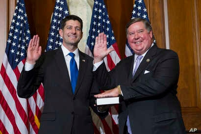 House Speaker Paul Ryan of Wis. administers the House oath of office to Rep. Ken Calvert, R-Calif., during a mock swearing in ceremony on Capitol Hill in Washington, Jan. 3, 2017.