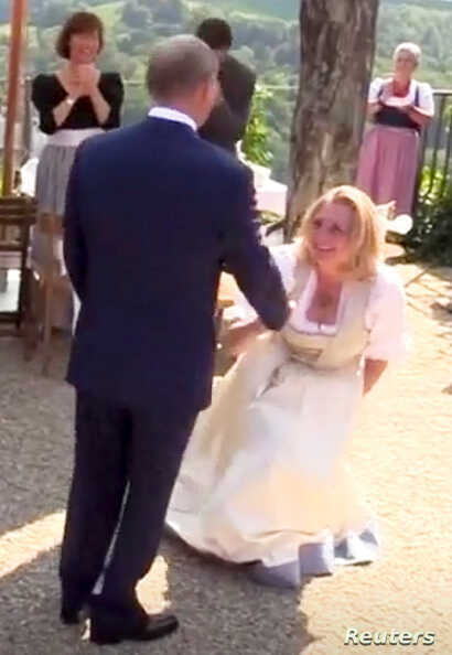 Austria's Foreign Minister Karin Kneissl dances with Russia's President Vladimir Putin at her wedding in Gamlitz, Austria, Aug. 18, 2018, in this picture grab taken from video.