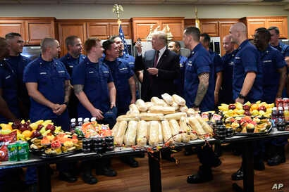 President Donald Trump meets with members of the U.S. Coast Guard stationed at United States Coast Guard Station Lake Worth Inlet in Riviera Beach, Fla., on Thanksgiving Day, Nov. 22, 2018.