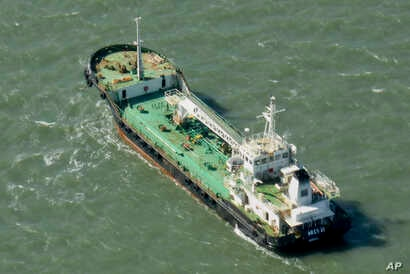 In this photo taken Monday, Oct. 27, 2014, the Aris 13 oil tanker is seen from a helicopter in the harbor of Gladstone, Australia. Pirates have hijacked the Aris 13 oil tanker off the coast of Somalia, officials and piracy experts said Tuesday, March...