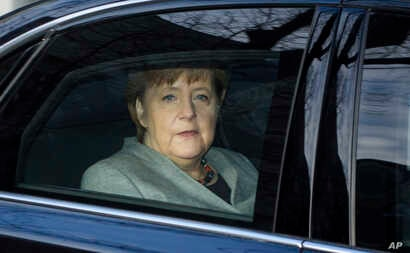 German Chancellor Angela Merkel arrives at the headquarters of the Social Democratic party in Berlin, Monday, Feb. 5, 2018 prior to another day in the coalition talks on forming a new German government between Merkel's Christian Democratic bloc and t...