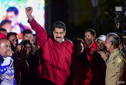 """Venezuelan President Nicolas Maduro celebrates the results of """"Constituent Assembly"""", in Caracas, July 31, 2017."""