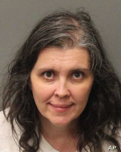 This Jan. 18, 2018, photo provided by Riverside County Sheriff's Department shows Louise Anna Turpin.