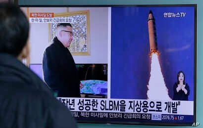 "A man watches a TV news program showing photos published in North Korea's Rodong Sinmun newspaper of North Korea's ""Pukguksong-2"" missile launch and North Korean leader Kim Jong Un at Seoul Railway Station in Seoul, South Korea, Feb. 13, 2017."