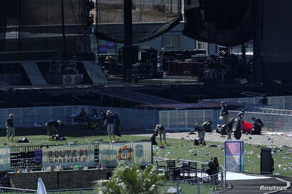 An FBI Evidence Response Team investigates the crime scene in front of the stage area following the mass shooting in Las Vegas, Nevada, Oct. 4, 2017.