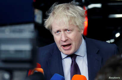 Britain's Foreign Secretary Boris Johnson talks to the media as he arrives at an European Union foreign ministers meeting in Brussels, Belgium, March 19, 2018.