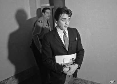 FILE - Robert Beausoleil, then 21, leaves a courtroom in Los Angeles, Jan. 21, 1970.