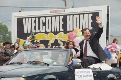In this June 22, 1992 file photo, former hostage Terry Anderson waves to the crowd as he rides in a parade in his honor in Lorain, Ohio.