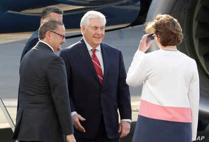 U.S. Secretary of State Rex Tillerson, center, is welcomed by U.S. Ambassador to Mexico Roberta Jacobson, right, and Mauricio Ibarra Ponce de Leon, North America director with Mexico's Foreign Ministry, as he arrives at the airport in Mexico City, Fe...
