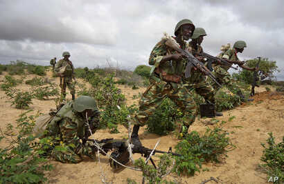 FILE - African Union peacekeepers are seen in the Deynile district of the capital Mogadishu, Somalia. Oct. 20, 2011. Local Somali officials have called on the African Union mission to launch an investigation into two deadly incidents over weekend all...