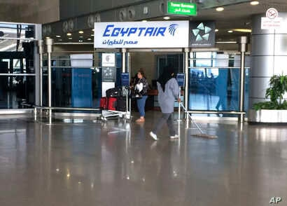 FILE -  the Egyptair logo is seen at the arrivals section of Cairo International Airport, Egypt.