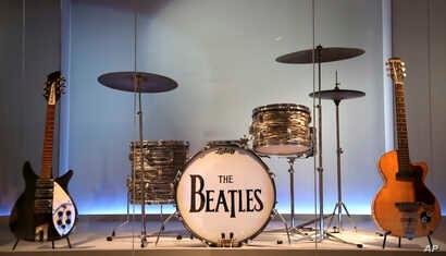 "Instruments used by members of The Beatles are displayed at the exhibit ""Play It Loud: Instruments of Rock & Roll"" at the Metropolitan Museum of Art in New York, April 1, 2019."