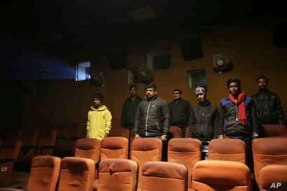 Indian moviegoers stand as national anthem is played at a cinema in Allahabad, India, Jan. 9, 2018.