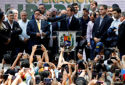 Venezuelan opposition leader Juan Guaido, who many nations have recognized as the country's rightful interim ruler, speaks during a meeting with political leaders in Caracas, Venezuela, March 27, 2019.