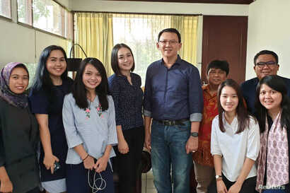 "Former Jakarta Governor Basuki ""Ahok"" Tjahaja Purnama poses with his relatives after being released from prison in Jakarta, Indonesia, Jan. 24, 2019."