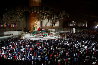 People attend a Mass remembering the victims of the recent 7.1-magnitude earthquake, at the Basilica of Guadalupe, in Mexico City, Sept. 24, 2017.
