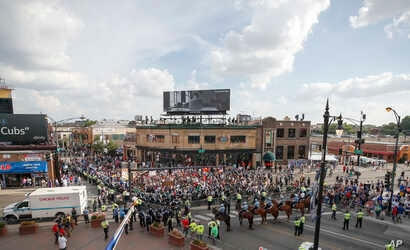 Protesters arrive at Wrigley Field to demand more government action against gun violence, Aug. 2, 2018, in Chicago.