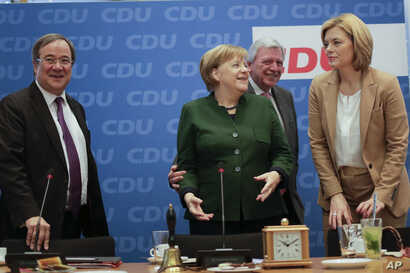 FILE - German Chancellor Angela Merkel, second from left, arrives with North Rhine-Westphalia state governor Armin Laschet (L), Hesse state governor Volker Bouffier (2nd from R), and Julia Kloeckner (R) for a board meeting of her Christian Democratic...