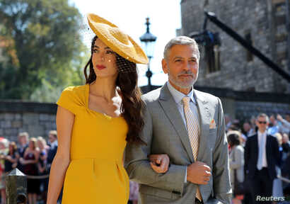 Amal Clooney and George Clooney arrive at St George's Chapel at Windsor Castle for the wedding of Meghan Markle and Prince Harry, May 19, 2018.