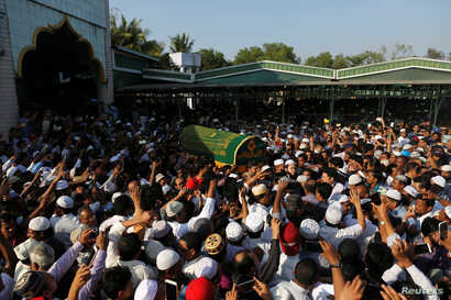 Supporters carry the coffin of Ko Ni, a prominent member of Myanmar's Muslim minority and legal adviser for Myanmar's ruling National League for Democracy, after he was shot dead, in Yangon, Myanmar January 30, 2017.