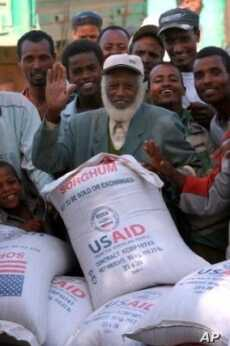 A man receives 50 kilograms of US sorghum in southern Ethiopia during 2010.