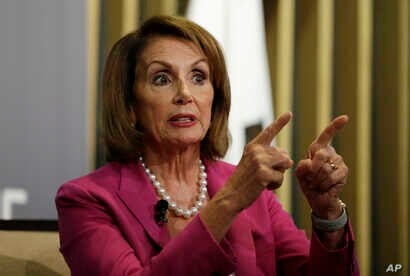 House Minority Leader Nancy Pelosi gestures while speaking at the Public Policy Institute of California, Aug. 22, 2018, in San Francisco.