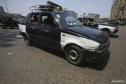 FILE - An old taxi is pictured on a street in Cairo.