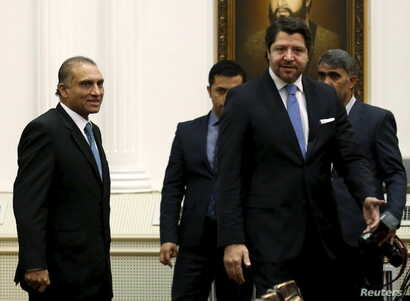 FILE - Pakistan's Foreign Secretary Aizaz Ahmad Chaudhry (L) and Afghanistan's Deputy Foreign Minister Hekmat Khalil Karzai (2nd R) arrive for a meeting in Kabul, Afghanistan, Jan. 18, 2016.