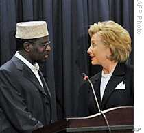 U.S. Secretary of State Hillary Clinton (R) shakes hands with Somali President Sheikh Sharif Sheikh Ahmed during a press conference at the U.S. embassy in Nairobi, Kenya