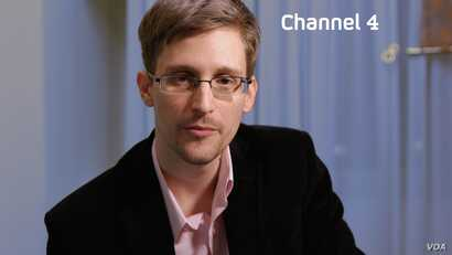 """Edward Snowden is seen delivering his """"Alternative Christmas Message"""" on Britain's Channel 4. (Channel 4)"""