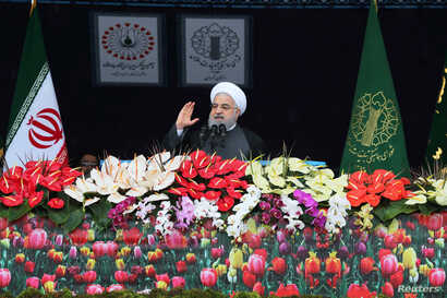 Iran's President Hassan Rouhani speaks during a ceremony to mark the 40th anniversary of the Islamic Revolution in Tehran, Feb. 11, 2019. (H. Zohrevand/Tasnim News Agency/via Reuters)