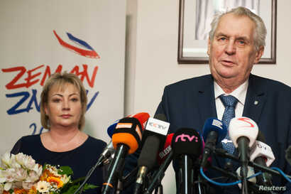 Czech President Milos Zeman, with his wife Ivana, attends a news conference, after polling stations closed for the country's presidential election, in Prague, Czech Republic, Jan. 13, 2018.