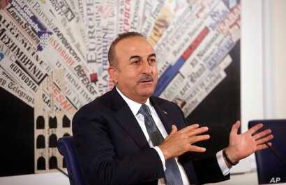 Turkish Foreign Minister Mevlut Cavusoglu talks at the Foreign Press Club, in Rome, Nov. 23, 2017.