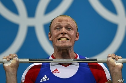 Russia's Andrey Demanov competes during the men's 94kg group A weightlifting event of the London 2012 Olympic Games at The Excel Centre in London on August 4, 2012.